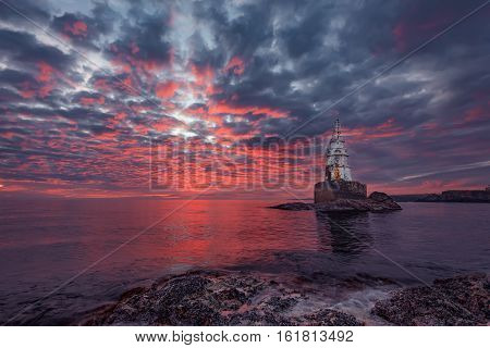 Magical fire sunrise at the Lighthouse, the town of Ahtopol, Bulgaria