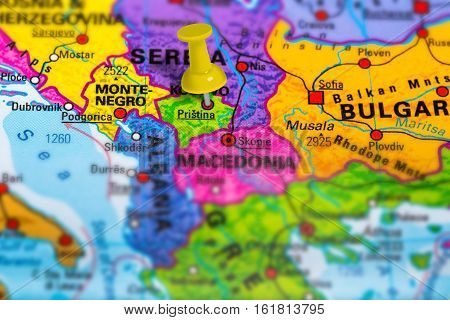 Pristina in Kosovo pinned on colorful political map of Europe. Geopolitical school atlas. Tilt shift effect. poster