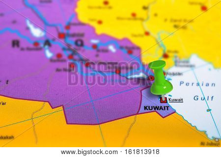 Kuwait city pinned on colorful political map of Middle East. Geopolitical school atlas. Tilt shift effect.