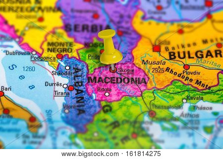Skopje in Macedonia pinned on colorful political map of Europe. Geopolitical school atlas. Tilt shift effect.