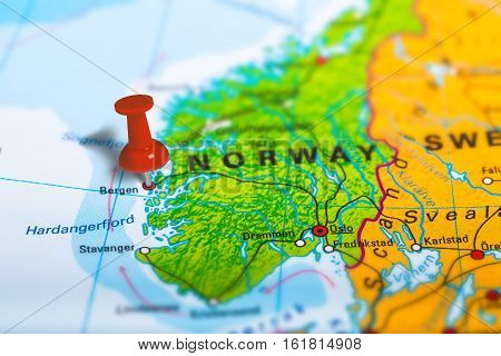 Bergen in Norway pinned on colorful political map of Europe. Geopolitical school atlas. Tilt shift effect.