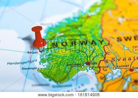 Bergen in Norway pinned on colorful political map of Europe. Geopolitical school atlas. Tilt shift effect.