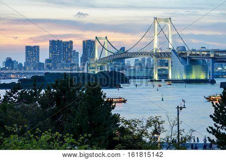 A twilight view of Rainbow Bridge in man-made Island Odaiba, Tokyo