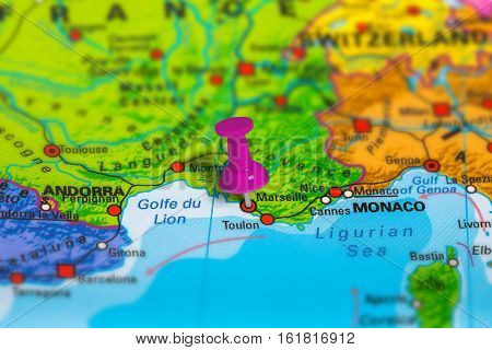 marseille in France pinned on colorful political map of Europe. Geopolitical school atlas. Tilt shift effect.