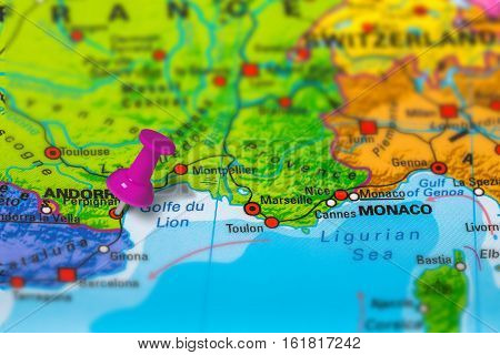 perpignan in France pinned on colorful political map of Europe. Geopolitical school atlas. Tilt shift effect.