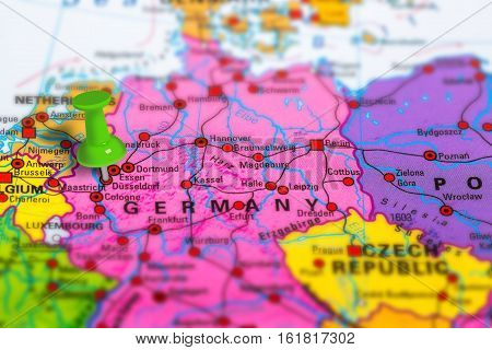 Dusseldorf in Germany pinned on colorful political map of Europe. Geopolitical school atlas. Tilt shift effect.