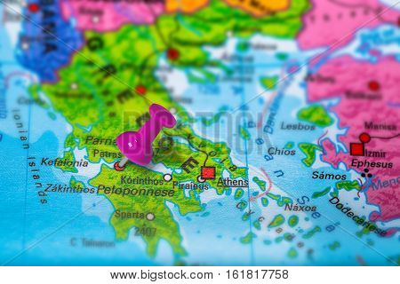 Petras in Greece pinned on colorful political map of Europe. Geopolitical school atlas. Tilt shift effect.