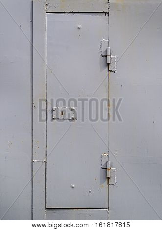 Close up of light gray steel gate of garage