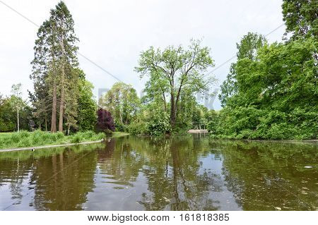 View on lake and trees with reflection at stadpark in vienna, austria