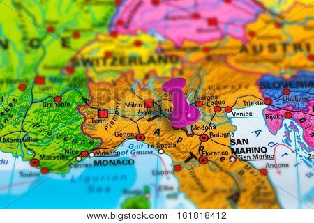 Modena in Italy pinned on colorful political map of Europe. Geopolitical school atlas. Tilt shift effect. poster