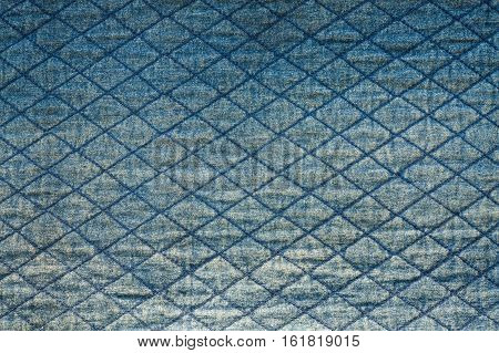 Old Jeans Texture Background With Seams Of Blue Color Close Up.