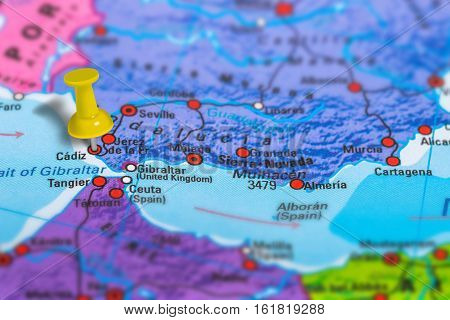 Cadiz in Spain pinned on colorful political map of Europe. Geopolitical school atlas. Tilt shift effect.