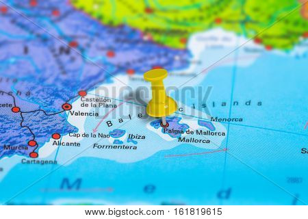 Palma De Mallorca in Spain pinned on colorful political map of Europe. Geopolitical school atlas. Tilt shift effect.