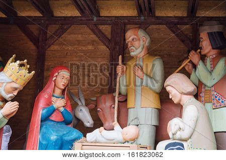 Christmas nativity scene with baby Jesus, Mary and Joseph in barn