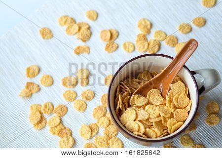 Spilling cornflakes. Cornflakes in a  bowl for breakfast