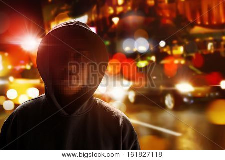 Hacker anonymous on the street at night
