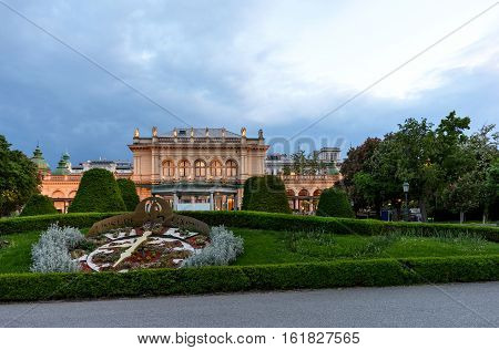 View on real big clock and buildings at stadpark in vienna at sunset, austria