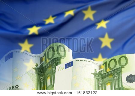 Two hundred Euro banknotes before the European flag