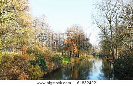 Winter landscape including river and trees in Brugge, Belgium