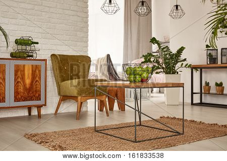 Flat With Table And Armchair