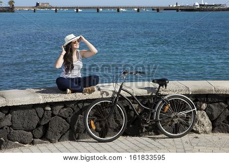 Young happy woman in sunglasses and hat enjoying travel to Lanzarote, Gran Canaria in Spain.
