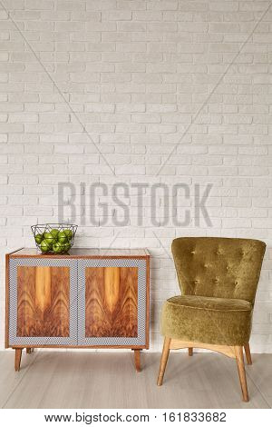 Brick Wall, Dresser And Chair