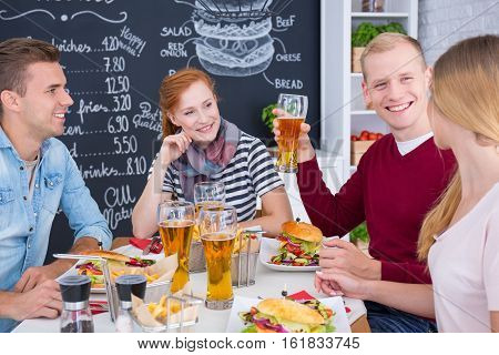 People Eating Burgers