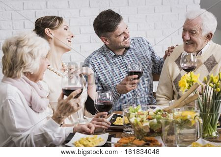 Laughing Family During Dinner