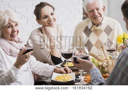 Smiling Members Of Family