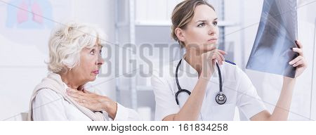 Lady And Doctor Looking At X-rays