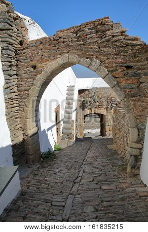 MONSARAZ, PORTUGAL: Typical narrow and cobbled street with arches