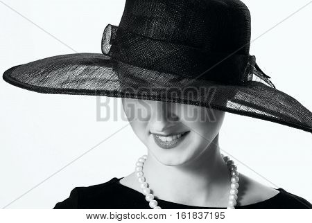 Close-up Portrait Of A Beautiful Woman In A Black Hat In Retro Style