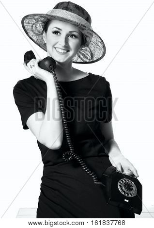 Portrait Of A Beautiful Brown-eyed Woman In A Little Black Dress With A Vintage Telephone