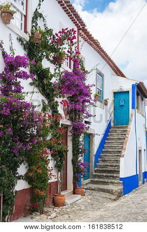 OBIDOS, PORTUGAL - OCTOBER 15, 2015: The street of Obidos in Portugal popular tourist destination because of its a well-preserved medieval architecture