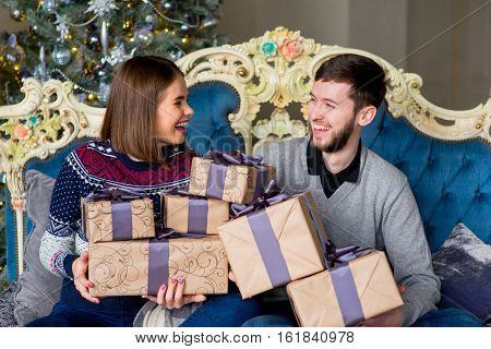 Couple Of Lovers Sitting On The Sofa. Christmas Time