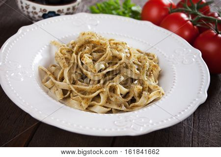 Italian pappardelle pasta with pesto genovese served in a plate