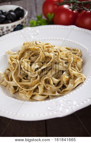 Italian pappardelle pasta with pesto genovese sauce