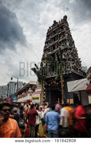 SINGAPORE - OCTOBER 23 2016: Chinatown and Sri Mariamman Temple October 23 2016 in Singapore. Singapore Chinatown crowded street place.