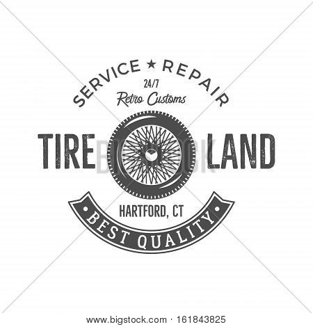 Vintage label design. Tire service emblem in monochrome retro style with old wheel and typography elements. Good for tee shirt design, prints, car service logo, repair station label, badge etc.
