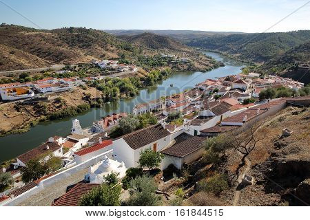 MERTOLA, PORTUGAL: General view of the fortified village and the surrounding hills from the castle