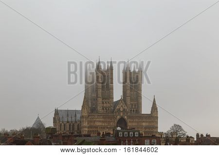 LINCOLN ENGLAND - DECEMBER 15: High view of Lincoln Cathedral from castle wall in fog. In Lincoln England. On 15th December 2016.