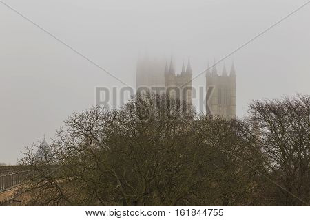 LINCOLN ENGLAND - DECEMBER 15: Spires of Lincoln Cathedral rise up out of the mist. In Lincoln England. On 15th December 2016.
