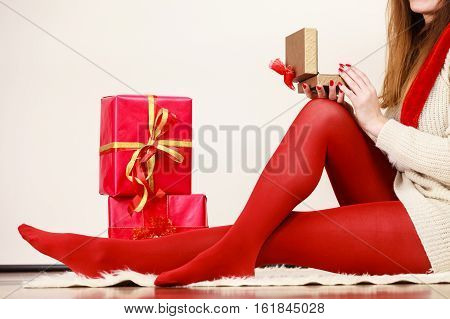 Female With Many Gift Boxes Sitting On Floor