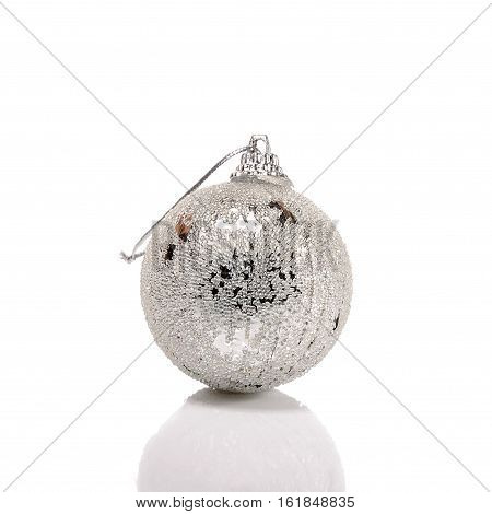 Silver dull christmas ball on white background.