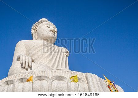 The Big Buddha in the blue sky, front view. Nakkerd hills in Ao Chalong, Phuket, Thailand. Phuket's Big Buddha is one of the island's most important and revered landmarks on the island.