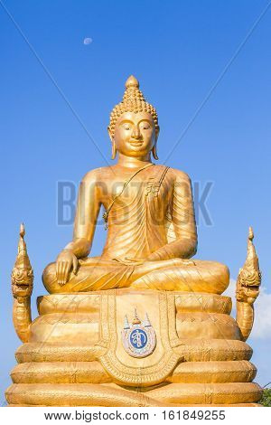 The Big Buddha Image golden color, made of 22 tons of brass and 12 meters high, in Chalong, Phuket, Thailand in blue background sky.