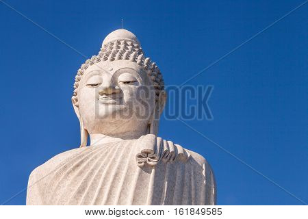 Close up of the Big Buddha head. Front view. Nakkerd hills in Ao Chalong, Phuket, Thailand. Visible almost everywhere, the Big Buddha has become one of the most popular attractions in Phuket