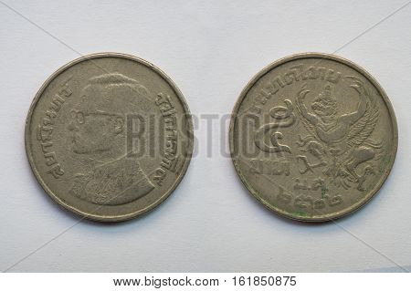 Old Thai coin on white background king and Garuda 5 baht B.E. 2522