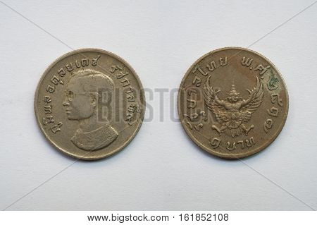 Old Thai coin on white background king and Garuda 1 baht B.E. 2517