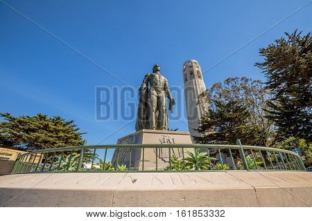 San Francisco, California, United States - August 14, 2016: Perspective view of the statue of Christopher Columbus and Coit Tower. North Beach, on Telegraph Hill.